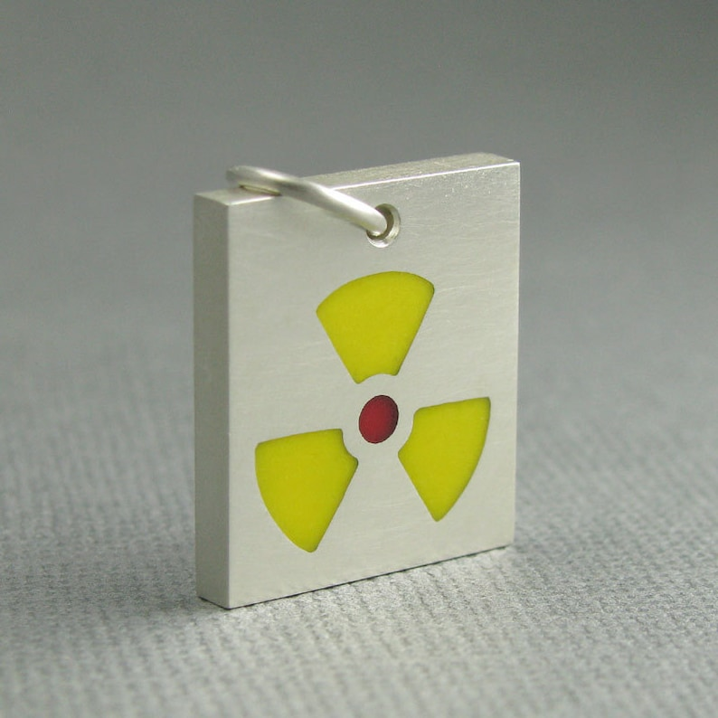 solid sterling silver radioactive pendant. radioactive icon image 0