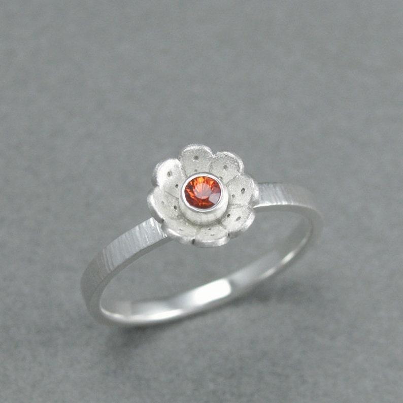 solid sterling silver orange sapphire flower ring. sterling image 0