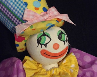 Clown Doll yellows pinks and purples