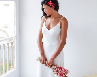 Simple and elegant slip wedding dress with thin spaghetti straps and low cut back