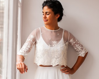 Romantic embroidered bridal top in scalloped tulle with crew neck and three quarter sleeves