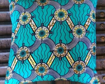 African wax fabric cushion in turquoise and yellow geometric design