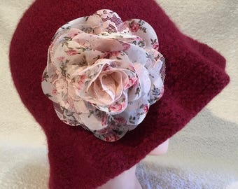 Ruby red hand knit felted wool cloche hat with ruffled brim and attached fabric pink rosette