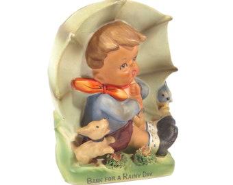 d8dd64e1ba4 Vintage Porcelain Hummel Boy with Umbrellas Rainy Day Bank