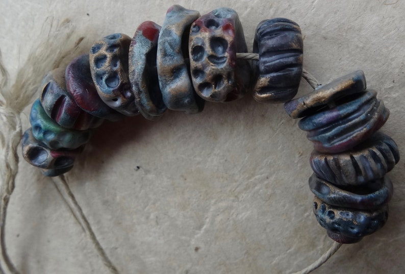 early Summer dusk textured ceramic disc bead set purple red blue red gold katy wroe K44