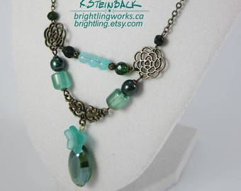 Garden Gate; Floral and Filigree Beaded Chain Necklace with Brilliant Aqua and Green Accents and Focal Emerald Crystal & Frosted Flower