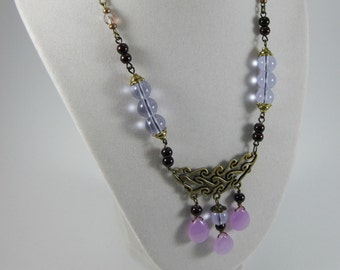 Purely Purple; A Sleek Adjustable Antiqued Bronze Necklace with Waves of Purple Hues in Clear, Opaque, Faceted, Metallic & Iridescent Glass