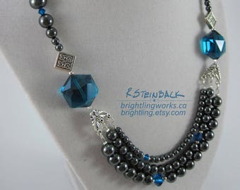 Toggle Clasp Necklace in Natural Hematite, Crystal and Faceted Glass.  Silver Findings set off Brilliant Ocean Blue & Rich Steel Grey Tones
