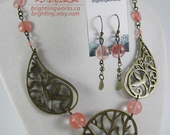 Climbing Roses; Rose Quartz and Antique Brass Findings of Stylized Trees and Leafy Branches Create a Necklace & Earrings with Natural Charm