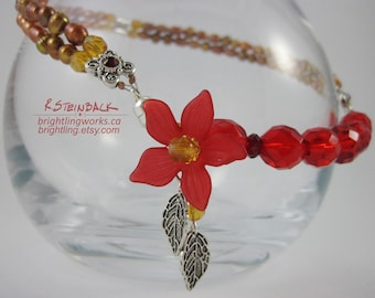 Warming Bloom; Floral Asymmetrical Magnet Clasp Necklace in Golden Freshwater Pearls Framing Vibrant Reds in Glass, Crystal & Silver Details
