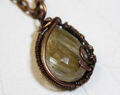 Rutilated Quartz Pendant...
