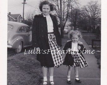 Vintage Photo of Sisters in Matching Outfits Posing on Sidewalk
