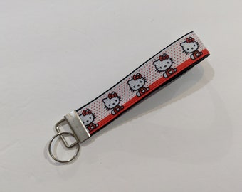 0eee4be5a Red and White Hello Kitty Key Fob Keychain wristlet