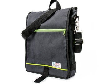 Dani, the Unisex messenger bag and backpack. Dark Grey cotton canvas with green details and lining. Multiple pockets. Everyday purse