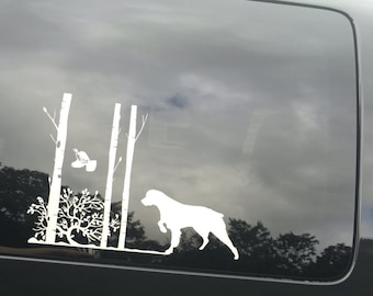 Vinyl Car Decal - Brittany Spaniel - Dog with Flushing Grouse & Trees - Dog Decal - 9 x 14 - white