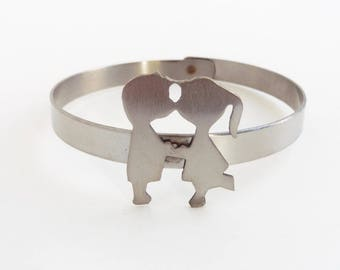 1970s kissing couple stainless steel bangle