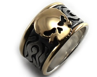 Skull ring in silver and 10k gold, or all silver, 14mm wide on top, 10mm at the bottom. Skull on top with flames pattern on the sides. #B109