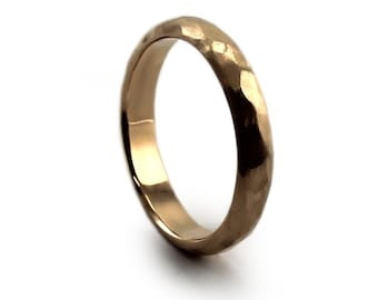 Ring band made of hammered solid 10k yellow gold. Half round ring 4mm wide and 2mm thick and is available in rose gold and yellow gold
