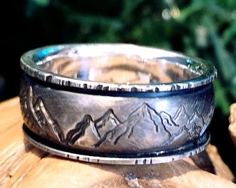 9mm ring band, silver, domed middle, mountains texture outside. READY TO GO