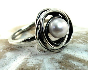 Ring with wire wrapped swirl around freshwater pearl, handmade with sterling silver, small. #B144