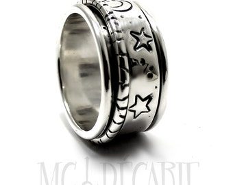 Spinner ring 14 mm wide, sun moon star design, only in sterling silver with 2 spinners, one 6mm spinner & one 2mm. #JC113