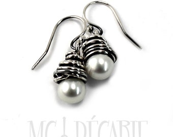 White pearl drop earrings, medium size silver swirl around a freshwater pearl, handmade earrings, each one is unique and different. #BO234