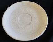 Beige or Ivory Fiesta 6 inch plate or saucer - 6 quot diameter - Stamped on back GENUINE fiesta H-LO USA