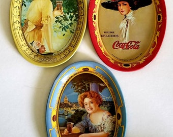 """3 Vintage Coca~Cola reproduction tin tip trays from 1973  4.5"""" W x 5"""" H Donning Pretty Vintage Ladies"""