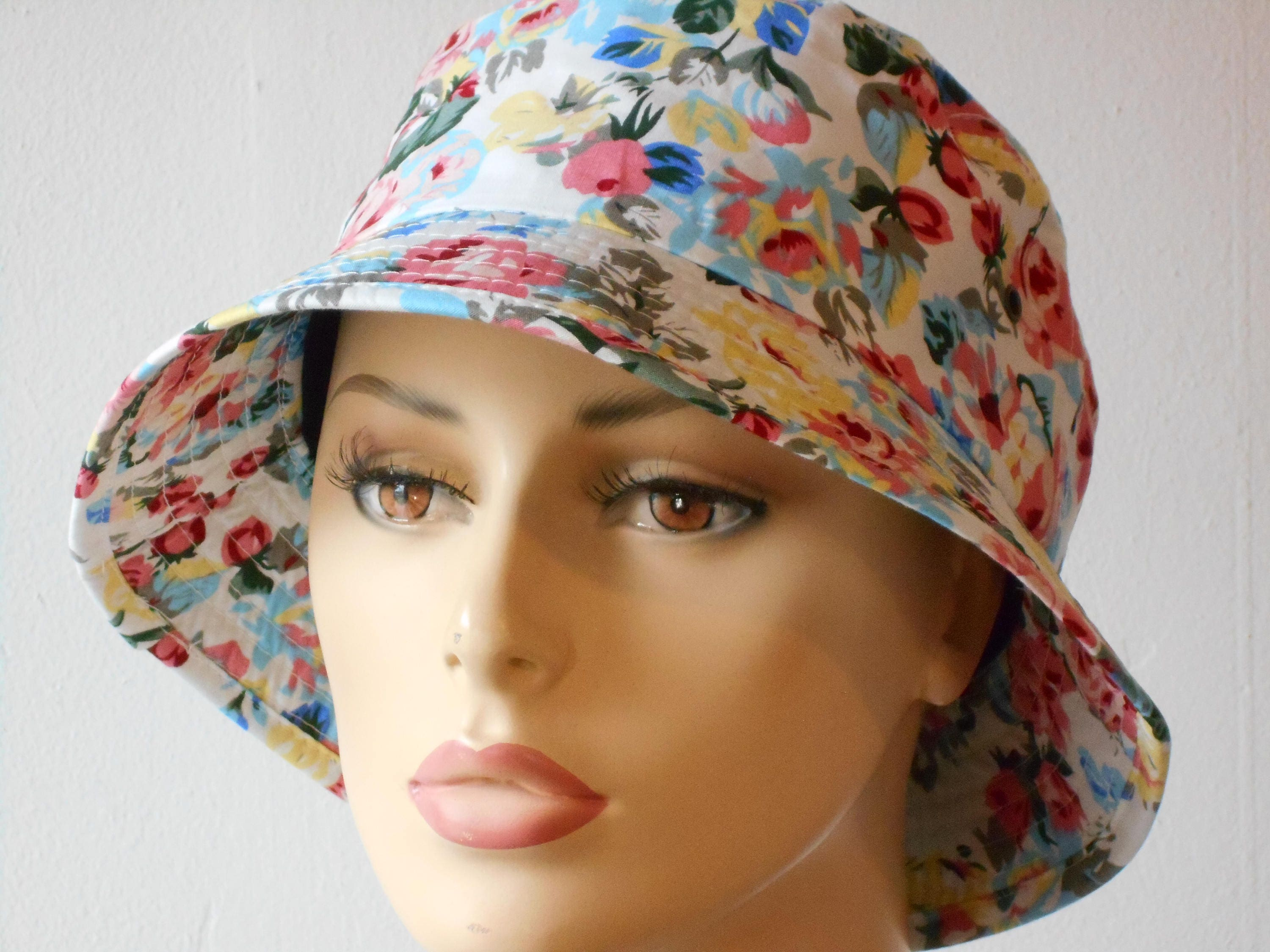 7dfa27842ec Bucket Hats White with Assorted Small Pink and Blue Flowers