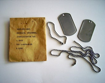 Vietnam War Era Dog Tag Set / 2 Personnel ID Tags No Notch & Set of long and short Dog Tag Ball Bead Chains in original 1965 sealed envelope