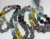 Amazonite, Labradorite, Lapis, Lepidolite, Amethyst, Tourmalinated Quartz, Citrine, Opal, Chalcedony, Garnet, Rainbow Moonstone Mala Beads