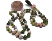 Pink and green mala beads...