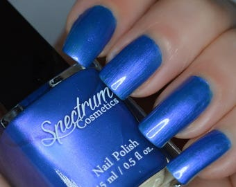 BLUE ORCHID Blue nail polish with violet iridescence