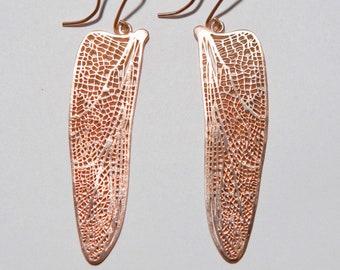 Dragonfly wings earrings.