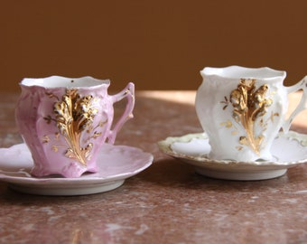 A Pair of delicate vintage demitasse/espresso/tea China Cups with Saucers, white and pink with gold designs