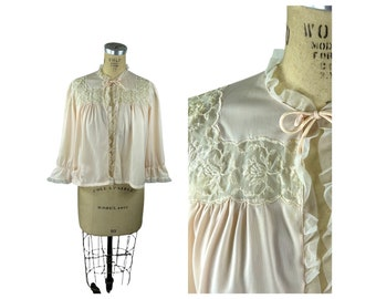 1950s pink bed jacket with embroidered sheer inserts and tulle ruffles by Wonder Maid