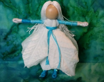 Waldorf Flower Fairy,  turquoise and white Poinsettia Ice faery, - bendy, art, worry doll, art doll