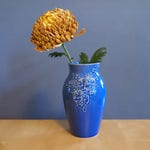 large vase with pansies in Delphinium