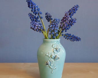 bud vase with sweet peas in aqua