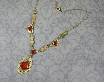 Antique 1910s to 1920s Gold Embossed Carnelian Glass Brass Filigree Pendant Necklace