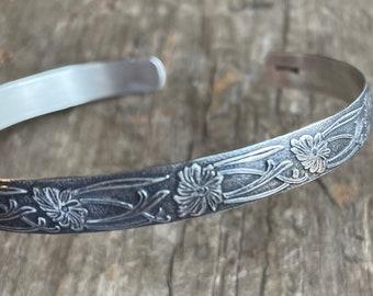 Floral silver cuff bracelet 7mm wide sterling silver floral cuff solid sterling silver with a floral and vine design
