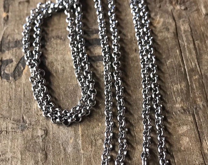 Solid stainless steel rolo chain