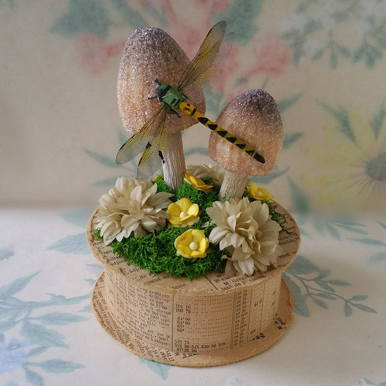 German Glass Glitter Mushrooms and vintage Millinery Flowers Yellow Realistic Dragonfly Keepsake Box Party Favor Antique French Newsprint
