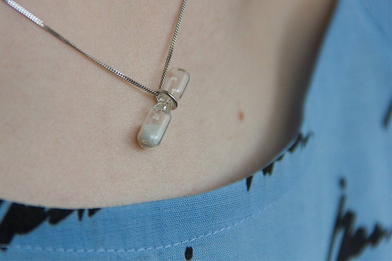time vintage tiny hourglass pendant on silver chain image 0