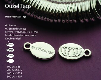 Custom metal tags created for your jewelry or product by ouzel