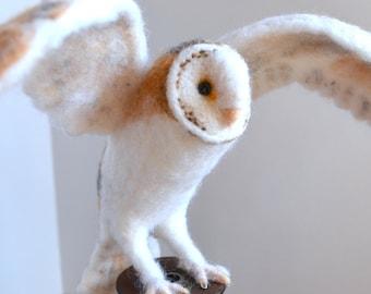 Mr. Barn Owl sitting on a vintage spool, needle felted bird sculpture