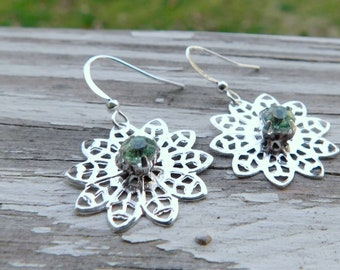 The Snow Bunny Snowflake earrings.  Emerald Rhinestone silverplate dangle earrings