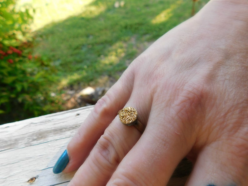 The Gilded Druzy Ring Gold Druzy Titanium Coated Crystal Cabochon ring.