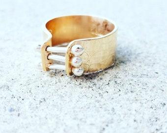 Gold corset ring