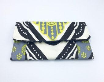 Fold-over clutch in Trina Turk Tangier Frame Designer Indoor Outdoor fabric in black, white, yellow and gray, one of a kind